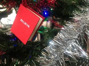 """""""Believe"""" book ornament"""