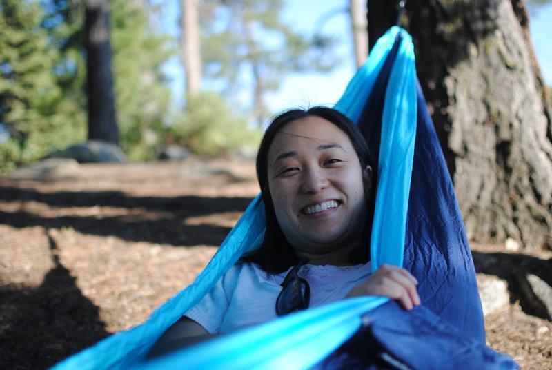 Jennifer Chow sitting up in a blue hammock